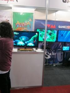 Aritana e a Pena da Harpia à esquerda e Pier Solar HD da Watermelon Magical Game Factory logo ao lado.